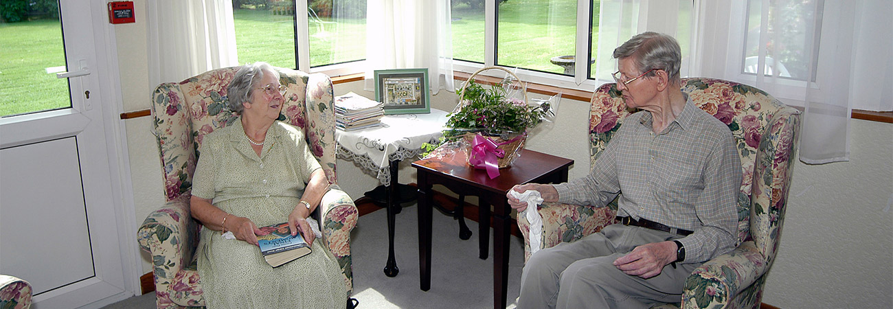 Residents couple enjoying the conservatory