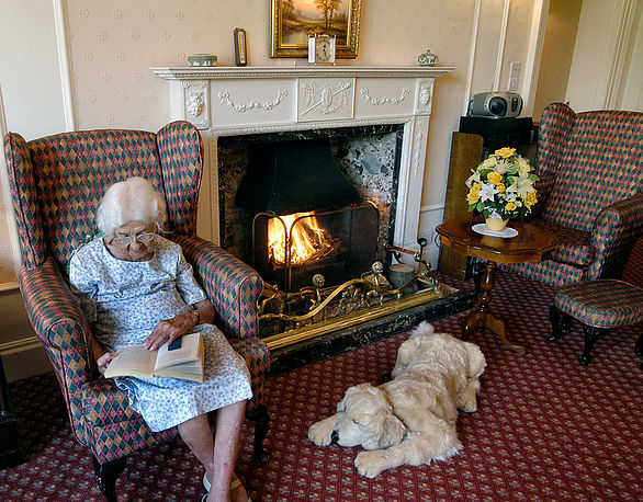 Heyfields resident relaxing and reading book